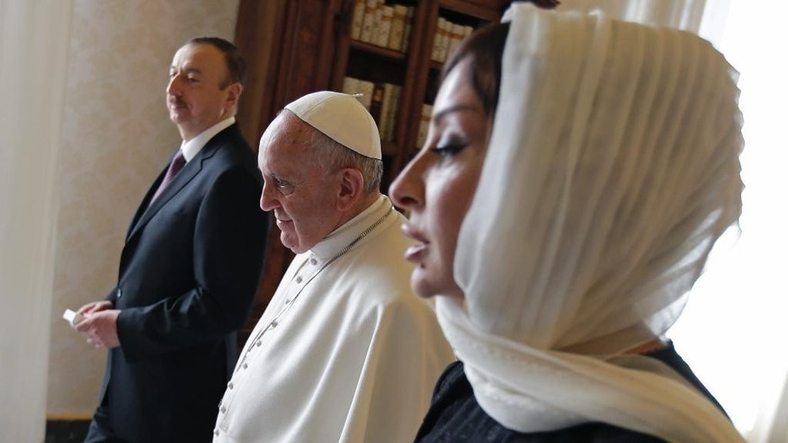 FILE -  In this Friday, March 6, 2015 file photo, Pope Francis meets with Azerbaijan's President Ilham Aliyev, left, and his wife Mehriban Aliyeva, right, during a private audience at the Vatican. Aliyev appointed his wife to the post of the ex-Soviet nation's first vice president on Tuesday, Feb.21, 2017, a new position created after last year's constitutional referendum. (AP Photo/Max Rossi, Pool, File)