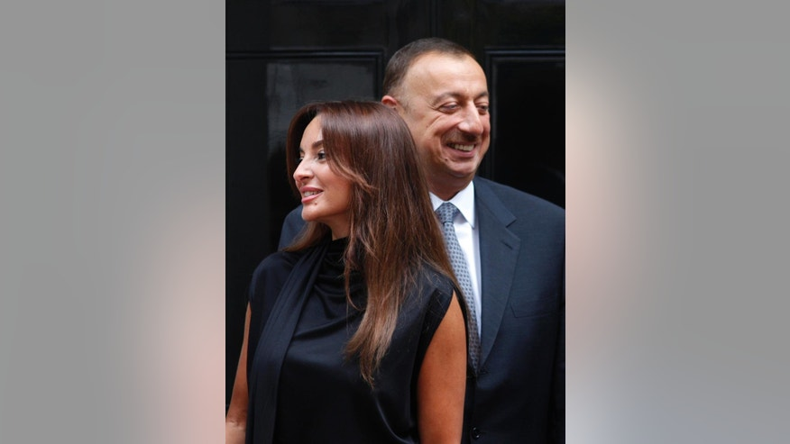 FILE - In this Monday, July 13, 2009 file photo, Azerbaijan's President Ilham Aliyev and his wife Mehriban Aliyeva pose outside the official residence at 10 Downing Street in central London. Aliyev appointed his wife to the post of the ex-Soviet nation's first vice president on Tuesday, Feb.21, 2017, a new position created after last year's constitutional referendum. (AP Photo/Lefteris Pitarakis, File)