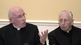 FILE - In this Monday, April 8, 2002 file photo, Archbishop of Armagh Sean Brady, left, makes a point as Cardinal Desmond Connell looks on, during a press conference after the meeting of Ireland's Catholic bishops at St Patrick's College, Maynooth County Meath, Ireland. Catholic Cardinal Desmond Connell, whose tenure as Dublin archbishop was dominated by revelations of pedophilia in the priesthood, has died at the age of 90. The Dublin Archdiocese said Connell died Tuesday, Feb. 21, 2017 in his sleep after a long illness. He oversaw the archdiocese from 1988 to 2004 and was elevated to cardinal in 2001. (AP Photo/John Cogill, file)