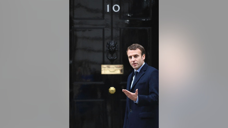 French presidential candidate Emmanuel Macron arrives at 10 Downing Street to meet with British Prime Minister Theresa May for talks, in London, Tuesday, Feb. 21, 2017.  (Stefan Rousseau//PA via AP)