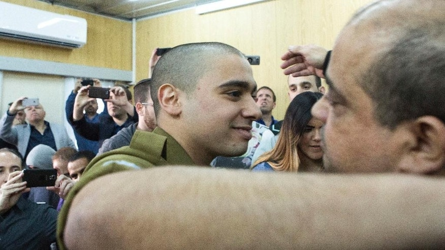 Israeli soldier Elor Azaria arrives at the military court for his sentencing hearing in Tel Aviv, Israel, Tuesday, Feb. 21, 2017. The court sentenced Azaria to 18 months in prison for the fatal shooting of a wounded Palestinian assailant. Prosecutors had asked that Sgt. Elor Azaria be sentenced to 3-5 years in prison. (Jim Hollander, Pool, via AP)