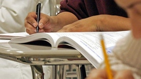 Students work out math problems during a class for Hispanic adults, Wednesday, March 16, 2005, at Cary High School in Cary, N.C.  Even among Hispanics 16-to-19 who were educated entirely in the United States, 15 percent nationally are dropouts, compared with 12 percent for blacks and 8 percent for whites.   (AP Photo/ Karl DeBlaker)