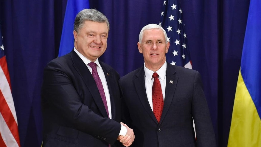 "United States Vice President Mike Pence, left, and Ukrainian President Petro Poroshenko meet for bilateral talks during the Munich Security Conference in Munich, Germany, Saturday, Feb. 18, 2017. America's commitment to NATO is ""unwavering,"" Pence said Saturday, reassuring allies about the direction the Trump administration might take but leaving open questions about where Washington saw its relationship with the European Union and other international organizations. (Mykola Lazarenko/Presidential Press Service Pool Photo via AP)"