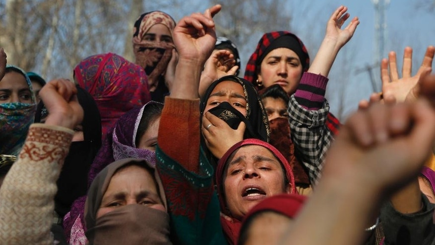 Kashmiri women shout anti Indian and pro-freedom slogans during a protest after a 60-year-old woman was killed in shootout at her residence in Moul village, 62 kilometers (39 miles) south of Srinagar, Indian controlled Kashmir, Thursday, Feb.23, 2017. Three Indian soldiers and a woman were killed after rebels ambushed soldiers in the disputed region of Kashmir, police said on Thursday. According to police, the attack triggered a brief exchange of gunfire and a stray bullet hit the 60-year-old woman while she was sleeping in her home. (AP Photo/Mukhtar Khan)