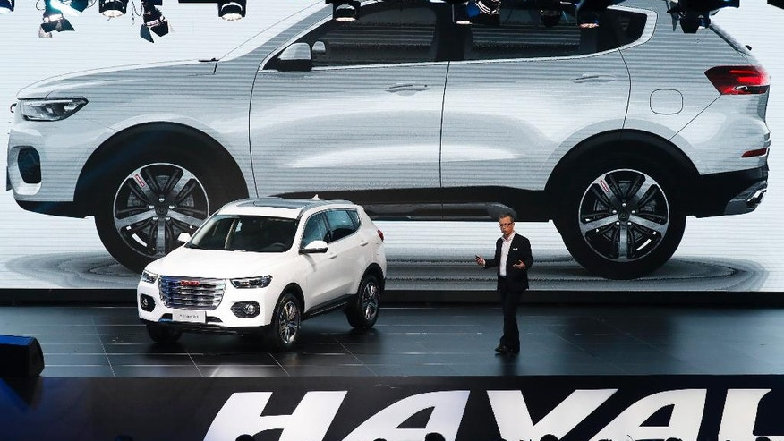 In this Sunday, Feb. 19, 2017 photo, Pierre Leclercq, vice president of Design for Haval SUV, talks about the new features on the newly unveiled Haval SUV H6 model during a reception celebrating it sales passing the one million mark, at the Great Wall headquarters in Baoding in north China's Hebei province. Great Wall Motors became China's most profitable automaker by making almost nothing but low-priced SUVs. Now it wants to expand into global markets. (AP Photo/Andy Wong)