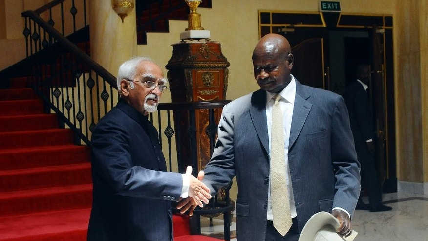 Vice President of India Shri M. Hamid Ansari, left, meets with Uganda's President Yoweri Museveni, right, at State House in Entebbe, Uganda Wednesday, Feb. 22, 2017. Ansari is on a three-day bilateral visit to the East African nation. (AP Photo/Ronald Kabuubi)