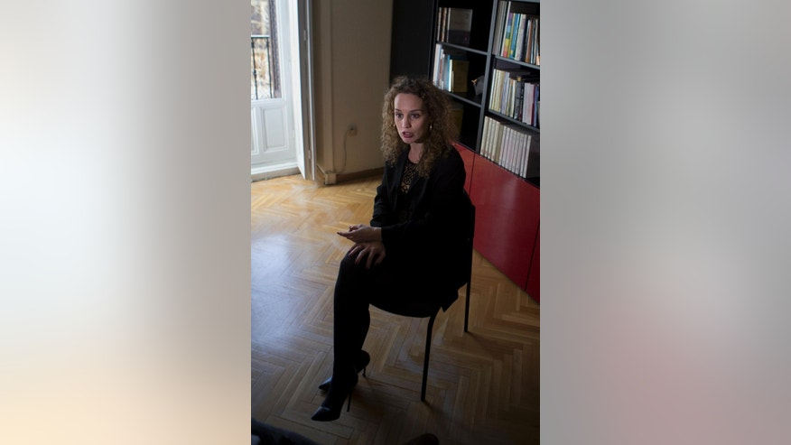 In this photo taken on Feb. 15, 2017, Maite Parejo, one of the lawyers spearheading the case against nine officials of the Syrian government speaks during an interview with The Associated Press in Madrid, Spain. A judge in Spain's National Court is deciding over the next few days whether to accept the criminal complaint filed by a group of international lawyers against nine officials of the Syrian government for the 2013 arbitrary detention, disappearance, torture and execution of a truck driver. (AP Photo/Paul White)