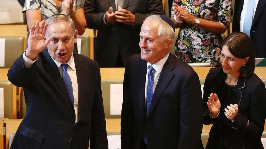 "Israeli Prime Minister Benjamin Netanyahu, left, and Australian Prime Minister Malcolm Turnbull, center, arrive at the Central Synagogue in Sydney, Australia, Wednesday, Feb. 22, 2017. Netanyahu on Wednesday praised Australia for being ""courageously willing to puncture U.N. hypocrisy"" on Anti-Israel resolutions. Turnbull marked the first visit to Australia by a serving Israeli leader by writing an opinion piece in Wednesday's The Australian newspaper. (Mark Metcalfe/Pool via AP)"