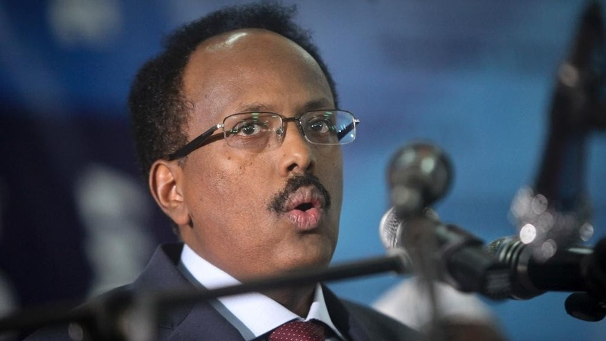"Somalia's President Mohamed Abdullahi Mohamed speaks at his inauguration ceremony in Mogadishu, Somalia, Wednesday, Feb. 22, 2017. Somalia's new leader, who also holds U.S. citizenship, was inaugurated Wednesday while promising to restore dignity to the troubled Horn of Africa nation but warning it will take another two decades to ""fix"" the country. (AP Photo/Farah Abdi Warsameh)"
