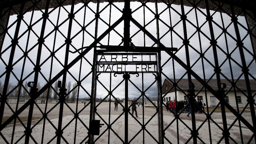 A copy of the historic gate of the memorial site of the former concentration camp Dachauis photographed in Dachau, Germany, Wednesday Feb. 22, 2017. The 100 kilogram original historic gate made of  iron was stolen in 2014 and reappeared in November 2016 near the city of Bergen in Norway. The original gate was returned to the memorial site today.  (Sven Hoppe/dpa via AP)