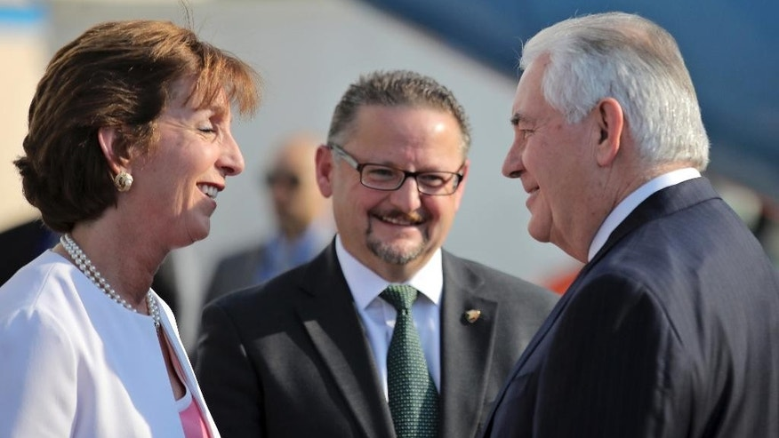 U.S. Secretary of State Rex Tillerson is welcome by U.S. ambassador Roberta Jacobson, left, and Mauricio Ibarra, center, director of North American affairs at the Mexican foreign affairs ministry as he arrives at Benito Juarez international Airport in Mexico City, Wednesday, Feb. 22, 2017. (Carlos Barria/Pool photo via AP)