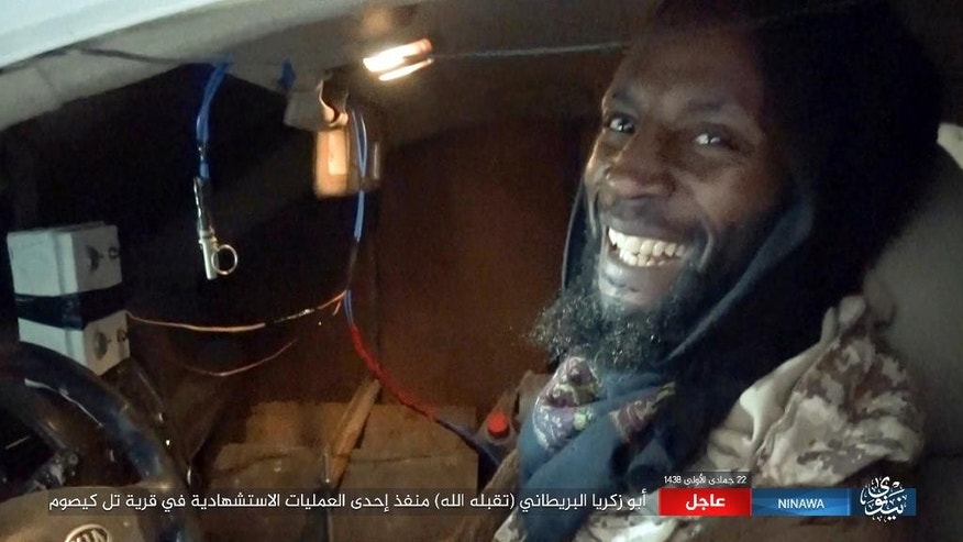 This militant photo released by Ninawa State – a media arm of the Islamic State group on Tuesday, Feb. 21, 2017 shows Abu Zakariya al-Britani, suicide bomber who attacked a military base in Iraq this week who was a former Guantanamo Bay detainee freed in 2004 after Britain lobbied for his release. The Islamic State group identified the bomber as Abu Zakariya al-Britani and two British security officials also confirmed the man featured in the Islamic State group video was a 50-year-old formerly Briton formerly known as Ronald Fiddler and as Jamal al-Harith. (Ninawa State via AP)