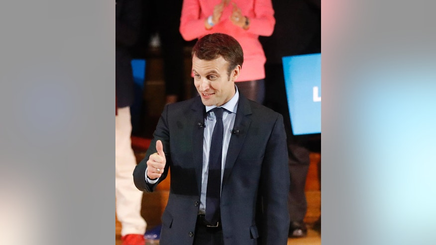 Emmanuel Macron, candidate for the 2017 French presidential elections, gives a thumb up to supporters as he attends an election campaign in London, Tuesday, Feb. 21, 2017.(AP Photo/Frank Augstein)