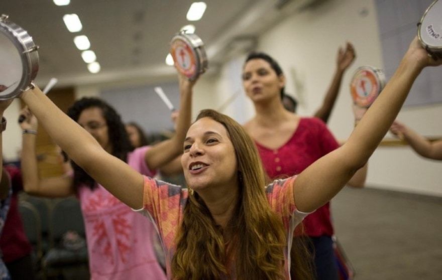 "In this Feb.16, 2017 photo, women sing during the rehearsal of the Sou Cheio de Amor or ""I am Full of Love"" block party in Rio de Janeiro, Brazil. Many Brazilians still reject evangelicals, seeing their mindset as contrary to the live-and-let-live attitude that remains a strong part of national culture. (AP Photo/Silvia Izquierdo)"