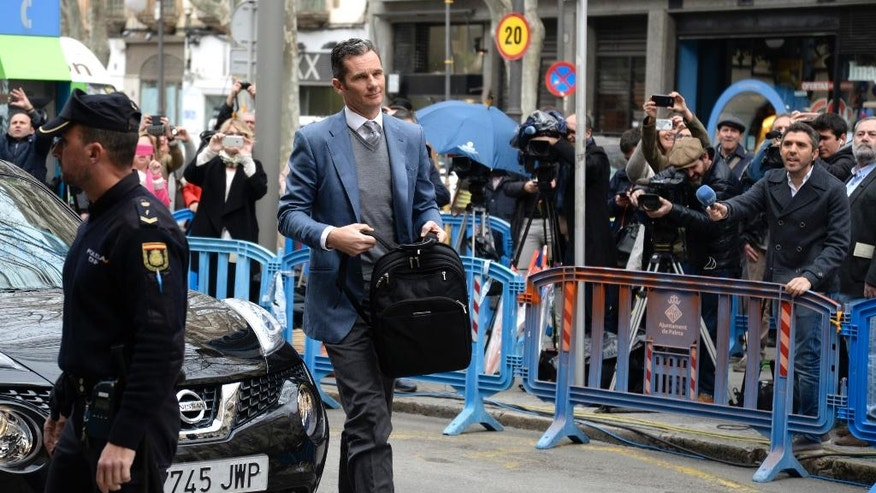 Spain's Princess Cristina's husband Inaki Urdangarin arrives at a courthouse in Palma de Mallorca, Spain, Thursday, Feb. 23, 2017. The Supreme Court decides whether King Felipe's brother-in-law should be imprisoned while he awaits the court ruling on his fraud and tax evasion case. The court sentenced Urdangarin last week to more than six years while absolving his wife, Princess Cristina. (AP Photo/Joan Llado)