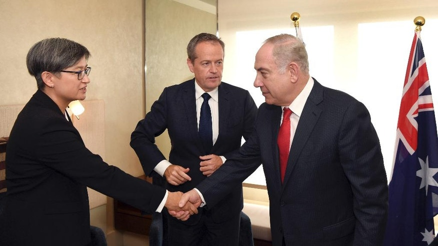 Israel's Prime Minister Benjamin Netanyahu, right, meets with the Federal opposition leader Bill Shorten, center, and senator Penny Wong in Sydney, Friday, Feb. 24, 2017. Prime Minister Netanyahu is on a four-day visit to Australia, the first official visit by an Israeli Prime Minister. (William West/Pool Photo via AP)