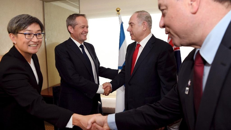Israel's Prime Minister Benjamin Netanyahu, second right, shakes hands with the Federal opposition leader Bill Shorten, second left, as Australian senator Penny Wong, left, meets Netanyahu's chief of staff, Yoev Horowitz, in Sydney, Friday, Feb. 24, 2017. Prime Minister Netanyahu is on a four-day visit to Australia, the first official visit by an Israeli Prime Minister. (William West/Pool via AP)