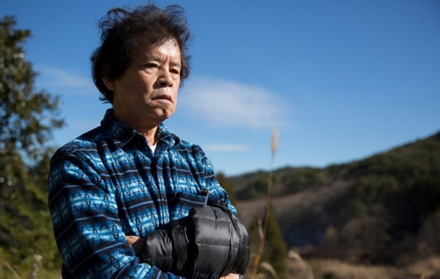 Toru Anzai in his garden that he had to be evacuated from.  Radiation survey around the house of Toru Anzai, who was evacuated from Iitate village in 2011 after the start of the Fukushima Daiichi nuclear disaster.