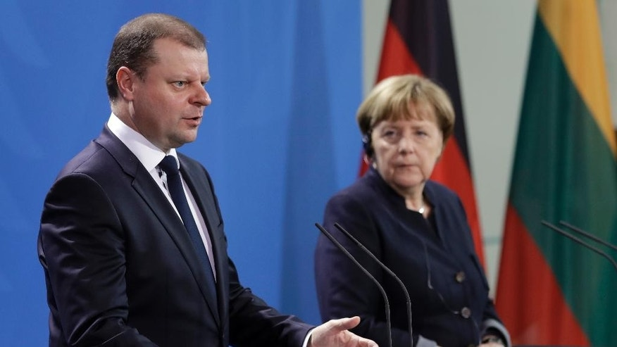 German Chancellor Angela Merkel, right, and the Prime Minister of Lithuania, Saulius Skvernelis, left, address the media during a joint press conference as part of a meeting at the chancellery in Berlin, Germany, Thursday, Feb. 23, 2017. (AP Photo/Michael Sohn)
