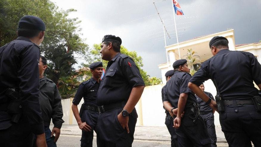 "Malaysian Police stand outside North Korean Embassy in Kuala Lumpur, Malaysia, Thursday, Feb. 23, 2017. North Korea denied Thursday that its agents masterminded the assassination of the half brother of leader Kim Jong Un, saying a Malaysian investigation into the death of one of its nationals is full of ""holes and contradictions."" (AP Photo/Vincent Thian)"