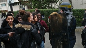 Students talk with a riot police officer as they protest against alleged police abuses in front of the Henri Bergson college, in Paris, Thursday, Feb. 23, 2017. (AP Photo/Thibault Camus)