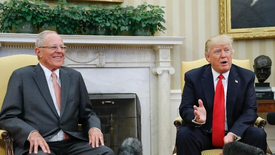 President Donald Trump meets with Peruvian President Pedro Pablo Kuczynski in the Oval Office of the White House in Washington, Friday, Feb. 24, 2017. (AP Photo/Pablo Martinez Monsivais)
