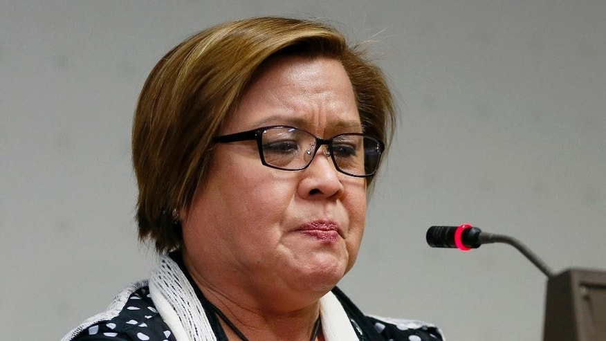 Opposition Senator Leila de Lima emotionally addresses the media after a warrant for her arrest was issued by a regional trial court Thursday, Feb. 23, 2017, in suburban Pasay city, south of Manila, Philippines. The Philippine court issued an arrest warrant on drug charges for the senator and former top human rights official who is one of the most vocal critics of President Rodrigo Duterte and his deadly crackdown on illegal drugs. De Lima has vehemently denied the charges, which she says are part of Duterte's attempt to intimidate critics of his crackdown, which has left more than 7,000 drug suspects dead. (AP Photo/Bullit Marquez)