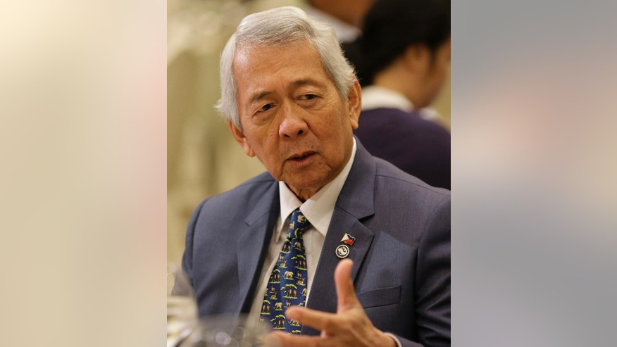 "Philippine Foreign Affairs Secretary Perfecto Yasay Jr. gestures as he talks to reporters in Manila, Philippines, Thursday, Feb. 23, 2017. Yasay said any move by China to transform a Manila-claimed shoal into an island would be a ""game-changer"" in blossoming relations although he added that Beijing has pledged not to undertake any construction in the strategically located area of the South China Sea. (AP Photo/Aaron Favila)"