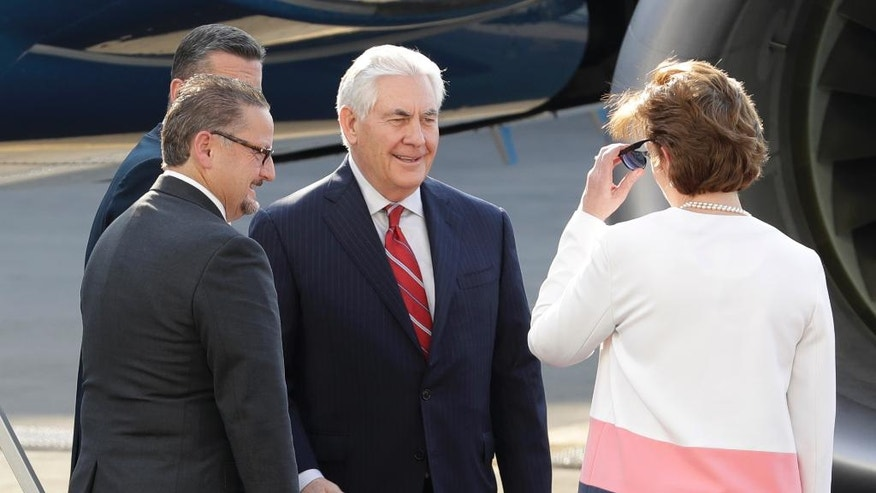 U.S. Secretary of State Rex Tillerson, center, is welcomed by U.S. Ambassador to Mexico Roberta Jacobson, right, and Mauricio Ibarra Ponce de Leon, North America director with Mexico's foreign ministry, as he arrives at the airport in Mexico City, Wednesday, Feb. 22, 2017. President Donald Trump has sent Tillerson and Homeland Security Secretary John Kelly to Mexico on a fence-mending mission made all the more challenging by the actual fence he wants to build on the southern border. (AP Photo/Rebecca Blackwell)