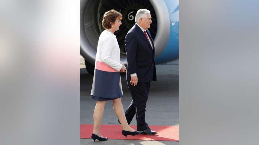 U.S. Secretary of State Rex Tillerson, right, walks with U.S. Ambassador to Mexico Roberta Jacobson, as he arrives at the airport in Mexico City, Wednesday, Feb. 22, 2017. President Donald Trump has sent Tillerson and Homeland Security Secretary John Kelly to Mexico on a fence-mending mission made all the more challenging by the actual fence he wants to build on the southern border. (AP Photo/Rebecca Blackwell)