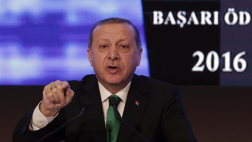 Turkey's President Recep Tayyip Erdogan addresses a business meeting in Ankara, Turkey, Wednesday, Feb. 22, 2017. Turkey will hold a national referendum in April 16 on expanding the president's powers. Critics say it would concentrate even more power in the hands of a leader they accuse of authoritarian behavior. (AP Photo/Burhan Ozbilici)