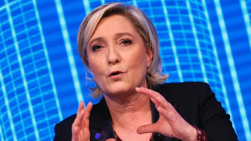 "Marine Le Pen, French far-right 2017 presidential candidate of the Front National party, participates to the Construction Forum debate ""Reinvest France"" (""Re-Investissons la France"") at Carrousel du Louvre in Paris, Thursday, Feb. 23, 2017. (AP Photo/Francois Mori)"