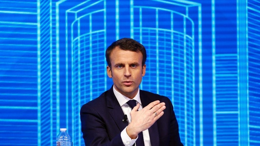 "Emmanuel Macron, candidate for the 2017 French presidential elections of the ""En Marche"" movement participates to the Construction Forum debate ""reinvest France"" (""Reinvestissons la France"") at Carrousel du Louvre in Paris, Thursday, Feb. 23, 2017. (AP Photo/Francois Mori)"