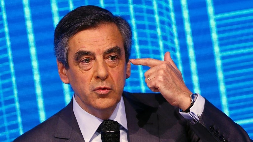"Francois Fillon, candidate for the 2017 French presidential elections of the right-wing Les Republicains (LR) party participates to the Construction Forum debate ""reinvest France"" (""Reinvestissons la France"") at Carrousel du Louvre in Paris, Thursday, Feb. 23, 2017. (AP Photo/Francois Mori)"