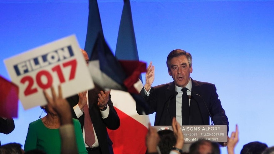 French conservative presidential candidate Francois Fillon delivers a speech during a campaign meeting in Maisons-Alfort, outside Paris, France, Friday, Feb. 24, 2017. The French financial prosecutor's office has decided to open a judicial inquiry into the allegedly fake parliamentary aide jobs that conservative presidential candidate Francois Fillon gave to his wife and two of his children. (AP Photo/Christophe Ena)