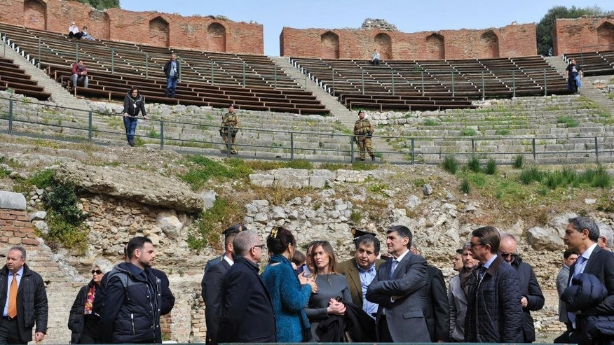 Italian Government Undersecretary Maria Elena Boschi, center, visits the ancient Greek theater of Taormina, Italy, the host town of the upcoming May 26-27 G-7 summit, Friday, Feb. 24, 2017. Italy still needs to build two helicopter landing pads and repave miles of road, but Boschi promised Friday that everything will be ready for the summit being held in the stunning Sicilian town overlooking the sea. (AP Photo/Salvatore Cavalli)