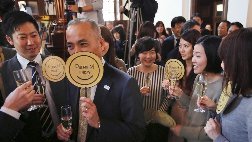 "Office workers of Tokyo area drink during a ""Premium Friday"" event in Tokyo Friday, Feb. 24, 2017. The event to mark the launching of ""Premium Friday,"" a joint project or concept endorsed by public and private sectors to promote work life balance as well as to revitalize economy by encouraging companies and workers to finish work at 1500 in the afternoon on every last Friday of the month. (AP Photo/Koji Sasahara)"