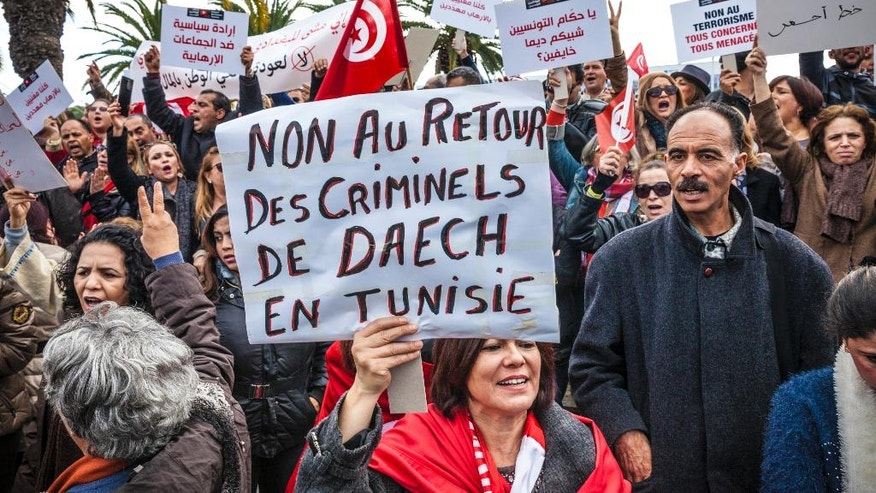 In this photo dated, Dec. 24, 2016, women demonstrate outside the Tunisian parliament, in Tunis, Saturday, Dec. 24, 2016. Poster reads : no to the return of Daesh's criminals in Tunisia. About 200 people have protested in the Tunisian capital against the return of Tunisian jihadis who have fought abroad. The gathering was prompted by the deadly truck attack in a Berlin Christmas market by Tunisian Anis Amri, who had pledged allegiance to the Islamic State group and was killed Friday in a police shootout. (AP Photo/Ons Abid)