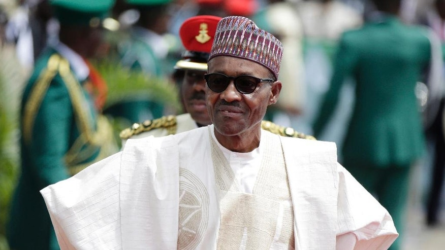 FILE - In this Friday, May 29, 2015 file photo, Nigerian President elect, Muhammadu Buhari, arrives for his Inauguration at the eagle square in Abuja, Nigeria. When Nigerian President Muhammadu Buhari left for London on Jan. 19 on a month-long medical leave he handed power to Vice President Yemi Osinbajo, a 59-year-old lawyer and pastor who has been empowered to attack the country's problems with an energy that has surprised observers and led some to suggest he should stay in charge for good.(AP Photo/Sunday Alamba, File)
