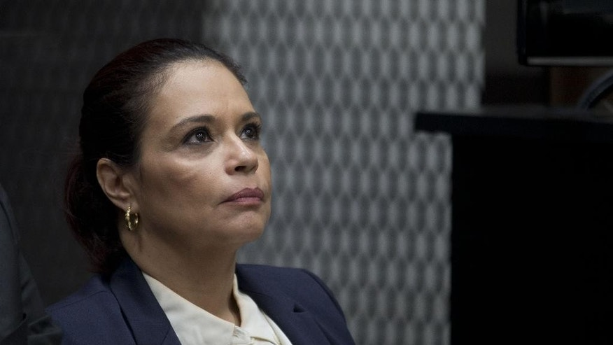 FILE - In this Aug. 24, 2015, file photo,  Guatemala's former Vice President Roxana Baldetti attends her hearing inside a courtroom in Guatemala City. The Unites States government is seeking Baldetti's extradition to the U.S. on drug trafficking charges, it was announced on Friday, Feb. 24, 2017. (AP Photo/Moises Castillo, File)