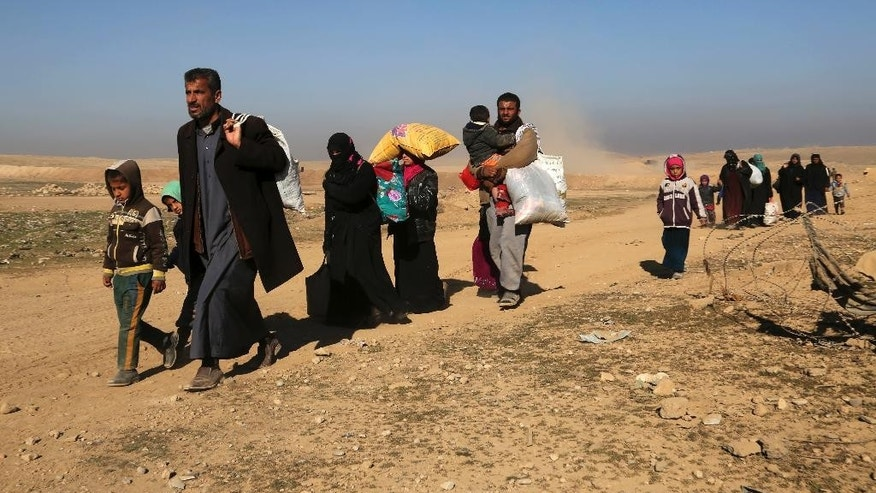 Displaced Iraqis flee their homes due to fighting between Iraqi special forces and Islamic State militants, on the western side of Mosul, Iraq, Saturday, Feb. 25. 2017. (AP Photo/ Khalid Mohammed)