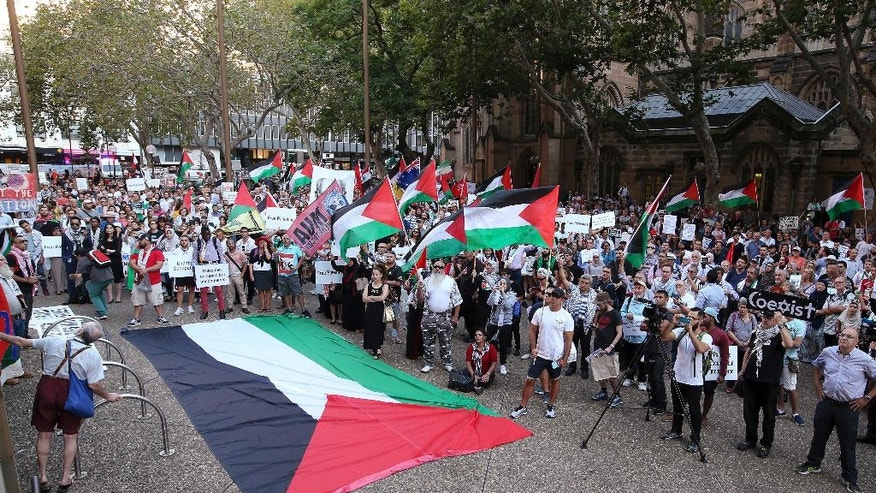 Members of the Palestinian community and their supporters gather to rally against a state visit of Israeli Prime Minister Benjamin Netanyahu in Sydney, Thursday, Feb. 23, 2017. Netanyahu is on a four-day visit to Australia. (AP Photo/Rick Rycroft)