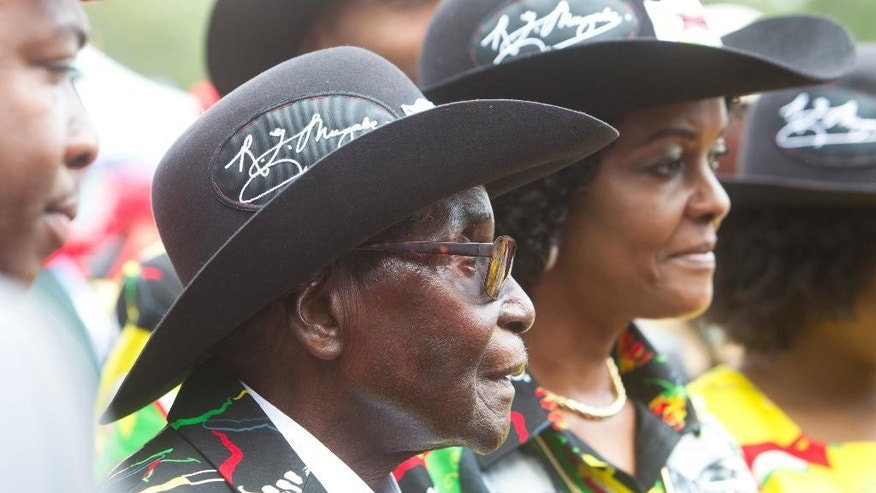 Zimbabwean President Robert Mugabe and his wife Grace attend his 93rd Birthday celebrations in Matopos on the outskirts of Bulawayo, Saturday, Feb. 25, 2017. Mugabe is defying calls to resign after nearly four decades in power, he has declared will run for office again in 2018 elections. (AP Photo/Tsvangirayi Mukwazhi)