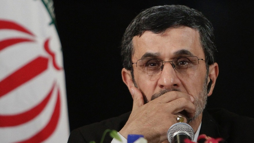 FILE- In this Wednesday, Sept. 26, 2012 file photo, President of Iran, Mahmoud Ahmadinejad listens during a news conference after addressing the 67th session of the United Nations General Assembly on Wednesday, Sept. 26, 2012 in New York.