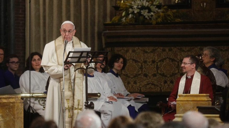 Pope Francis delivers his speech as reverend Robert Innes, right, the Anglican Bishop in Europe, listens, during his historic visit to the Anglican Church of All Saints in Rome, Sunday, Feb. 26, 2017. (AP Photo/Gregorio Borgia)
