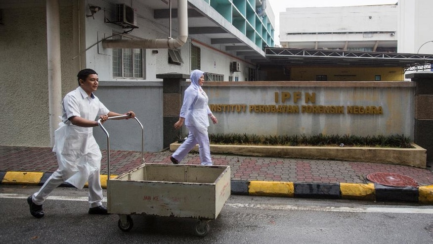 Medical personnel pass in front the gate of the National Forensic Institute at Kuala Lumpur Hospital in Kuala Lumpur, Malaysia, Sunday, Feb. 26, 2017. Malaysian police ordered a sweep of Kuala Lumpur airport for toxic chemicals and other hazardous substances following the killing of Kim Jong Nam. (AP Photo/Alexandra Radu)