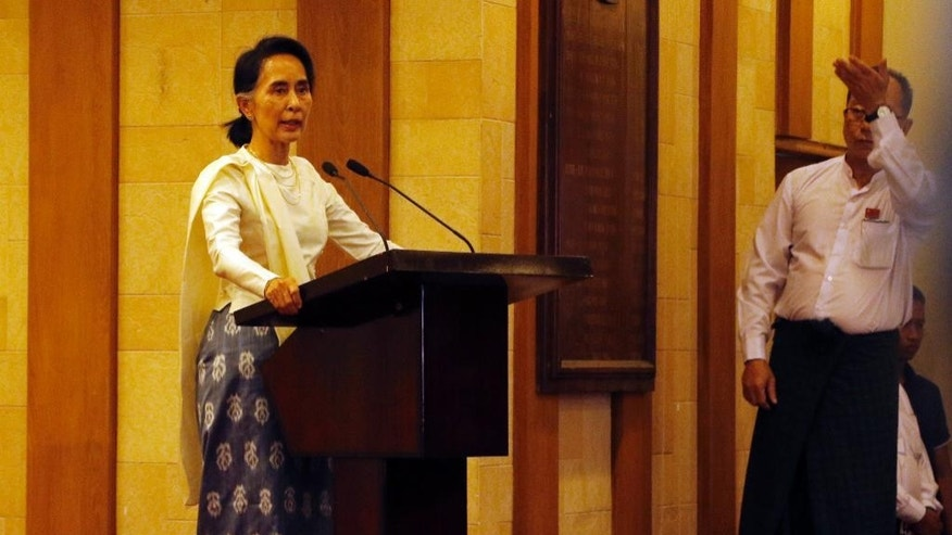 Myanmar State Counsellor Aung San Suu Kyi speaks at a memorial ceremony to mark one month from the killing of Ko Ni, prominent legal adviser to the government, and taxi driver Ne Win by a gunman at Yangon International airport, Sunday, Feb.26, 2017, in Yangon, Myanmar. (AP Photo/Thein Zaw)