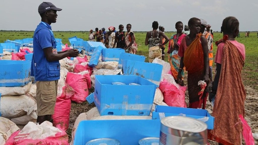 In this photo taken June 28, 2016 and released by the World Food Programme (WFP), people collect food assistance from WFP on the outskirts of Mayom, in Unity state, South Sudan. The United Nations needs $4.4 billion by the end of March to prevent catastrophic hunger and famine in South Sudan, Nigeria, Somalia and Yemen, yet just $90 million has been collected so far, Secretary-General Antonio Guterres said Wednesday, Feb. 22, 2017. (Challiss McDonough/WFP, via AP)