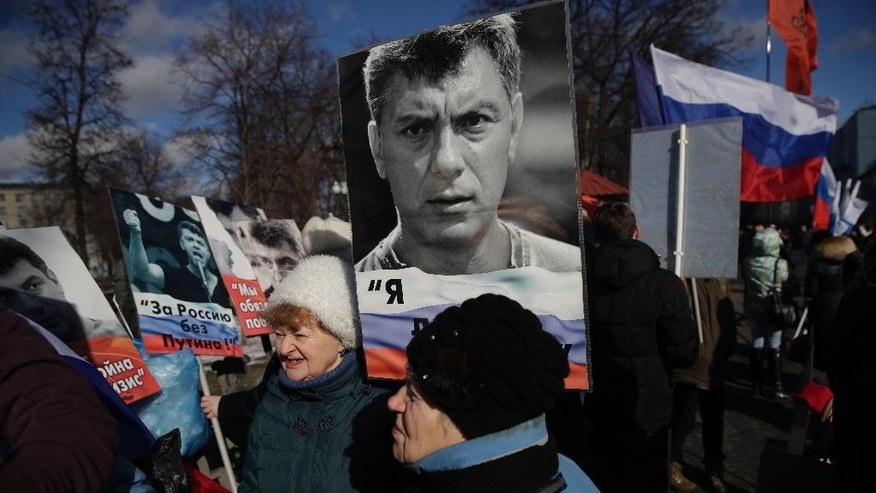 People gather together prior a march in memory of opposition leader Boris Nemtsov, who was killed two years ago, in Moscow, Russia, Sunday, Feb. 26, 2017. Several thousand people held a march in Moscow in memory of the Russian opposition leader to mark the second anniversary of his killing. (AP Photo/Pavel Golovkin)