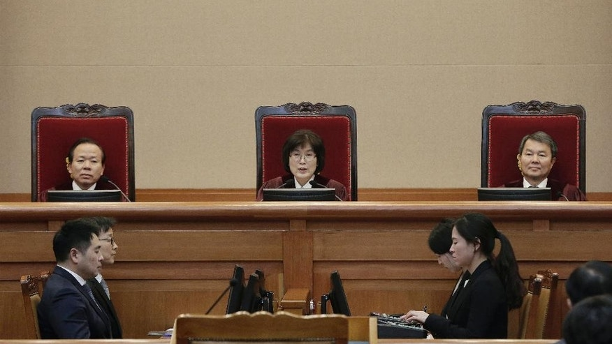 South Korean acting Constitutional Court's Chief Judge Lee Jung-mi, center, attends the final hearing on whether to confirm the impeachment of President Park Geun-hye at the court in Seoul, South Korea, Monday, Feb. 27, 2017. A special investigation team is wrapping up its probe into a huge scandal involving impeached Park after the country's acting leader refused to extend its investigation past a Tuesday deadline. (AP Photo/Ahn Young-joon, Pool)